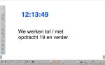 Tekst met een klok, die natuurlijk in de screenshot niet tikt...